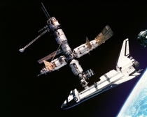 This view of the Space Shuttle Atlantis still connected to Russias Mir Space Station was photographed by the Mir- crew on July