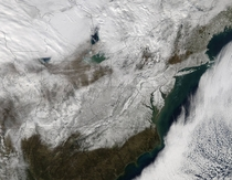 This visible image from the MODIS instrument aboard NASAs Aqua satellite on Jan  at  UTC  pm EST shows post-storm snow on the ground across eastern United States Credits NASA Goddard MODIS Rapid Respons