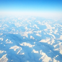 Those arent clouds that is the Arctic Tundra View from the plane leaving the North Slope of Alaska