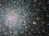 Though it appeared to Messier to be fuzzy and round and without stars Messier  M is now known to be a globular star cluster  stars or more bound by gravity and packed into a region around  light-years in diameter