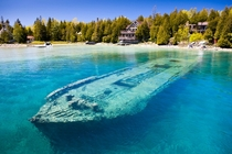 Though it sunk in  the Sweepstakes sits almost completely intact in just  feet of water in Lake Huron Rolf Hicker Photography