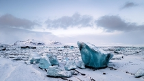 Thousands of chunks of ice fill the Jkulsrln glacial lagoon Iceland   x