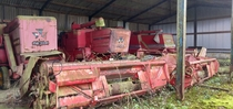 Three abandoned combine harvesters at an abandoned farm Buckinghamshire England