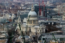 Three hundred year old St Pauls Cathedral surrounded by new construction