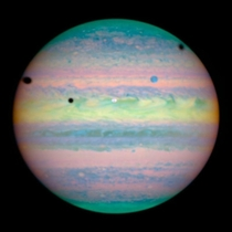 Three moons cast shadows on jupiter taken by the NASA Hubble space telescope