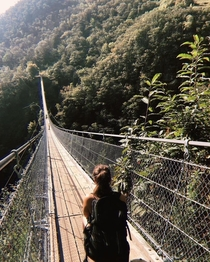 Tibetan Bridge Carasc in Switzerland is a  m long and rises  m above the ground