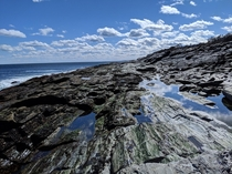 Tidal pools along slate rock Two Lights State Park Outside Portland Maine