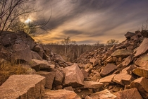 Time and mother nature has overtaken these granite mounds at Quarry park and nature preserve