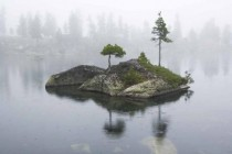Tiny isolated island in the middle of Artists Lake Ergaki Russia
