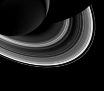 Tiny Mimas and Saturns ring spokes cassini released march
