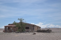 Toconao Chile -- an abandoned building with Licancabur Volcano in the distance