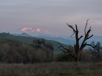 Todays alpenglow at Sierra Nevada Lasted for mere seconds glad I stopped in the middle of the road to take the picture