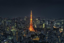 Tokyo tower glows bright above the city