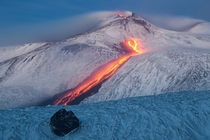 Tongue of Fire - lava streaming down the snowy sides of Mount Etna Italy  by Dreamerlandscapecom