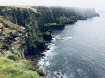 Took a muddy hike through the fog from Doolin Ireland to see the Cliffs of Moher