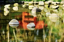Took from a park in Tokyo Japan No man-made stuffs here but the reflection of the red bridge enlightens what Zen really means