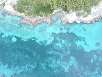 Took my Phantom  drone to the Bahamas and got this shot of rocky island meeting sea