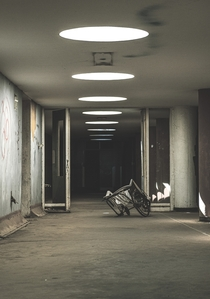 Took this image in a local abandon hospital in South Africa It is just an ominous hallway with a DIY wheelchair in the frame