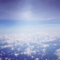 Took this last year approaching Singapore -clouds below was a beautiful sight