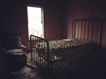 took this pic with my iphone  a few years back abandoned place with a plate on the bed lol