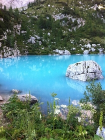 Took this picture at Lago di Sorapiss Northern Italy This is the original color of the lake no post-editing needed