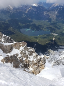 Top of the Zugspitze looking down at lake Eibsee  x