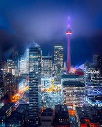 Toronto city scape in fog including the CN Tower Photo credit to Marcin Skalij