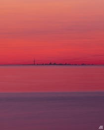 Toronto skyline sunset from opposite side of Lake Ontario