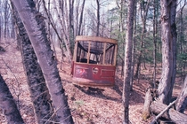 Toronto streetcar in a remote forest of northern Ontario Photographed with Ektar  film hence the reddish hue