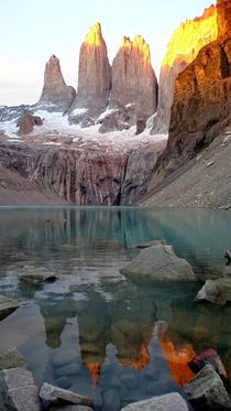 Torres del Paine with reflection over water