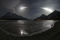 Total Lunar Eclipse Over Waterton Lake -- APOD