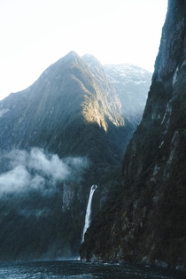 Towering peaks and waterfalls of Milford Sound New Zealand