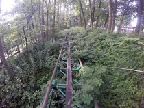 Tracks lead into the distance of Camelot an abandoned UK theme park