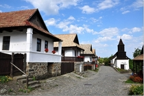 Traditional houses and chapel in Hollk Hungary