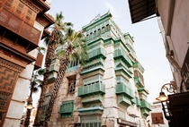Traditional houses are built of sea coral in the old town of Jeddah Saudi Arabia
