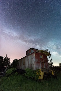 Train caboose under a Nebraska night sky