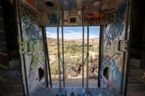 Train cars parked behind a nudist colony in the deserts of California