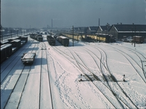 Train Yard in the snow December  by Jack Delano