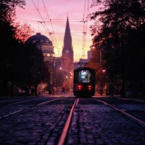 Tram rolling in the sunset of the Polish city of Poznan x