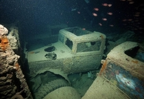 Trapped Classic British vehicles submerged near Egypt