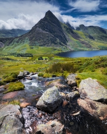 Tryfan in Snowdonia clouds around its shoulders North Wales UK