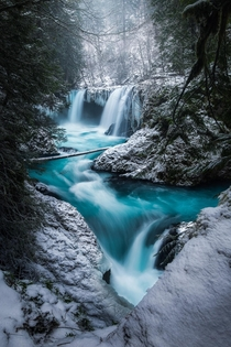Tucked away is Washington is one of my favorite waterfalls especially when it snows OC  ross_schram