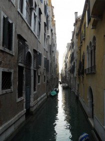 Two buildings separated by a canal in Venice Italy