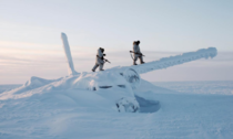 Two Canadian rangers conducting a survey mission on Cornwallis Island inspect a frozen wreckage of an aircraft that crash landed in that area many decades ago Nunavut Territory circa s