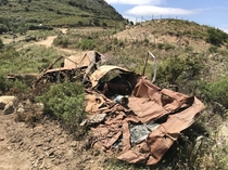 Two crashed cars left on the crash site in the countryside In Corsica The one in the front looks like it burned out