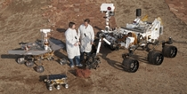 Two engineers stand with the three generations of Mars rovers developed at NASAs Jet Propulsion Laboratory  xpost rTechnologyPorn