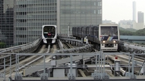 Two generations of rolling stock on Tokyos Yurikamome fully automated people mover system