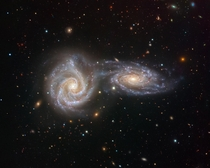 Two interacting spiral galaxies creating a singular astronomical object named Arp  located  million light years away The final image captured by VIMOS an instrument on ESOs VLT Very Large Telescope Credit - ESOJuan Carlos Muoz