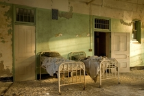 Two patient beds at sunset at the abandoned insane asylum in Buffalo NY