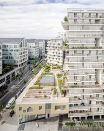 Two tower blocks of a new social housing project built on a former rail yard in th arrondissement of Paris